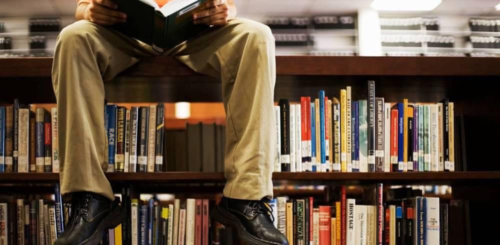 boy_on_bookshelf